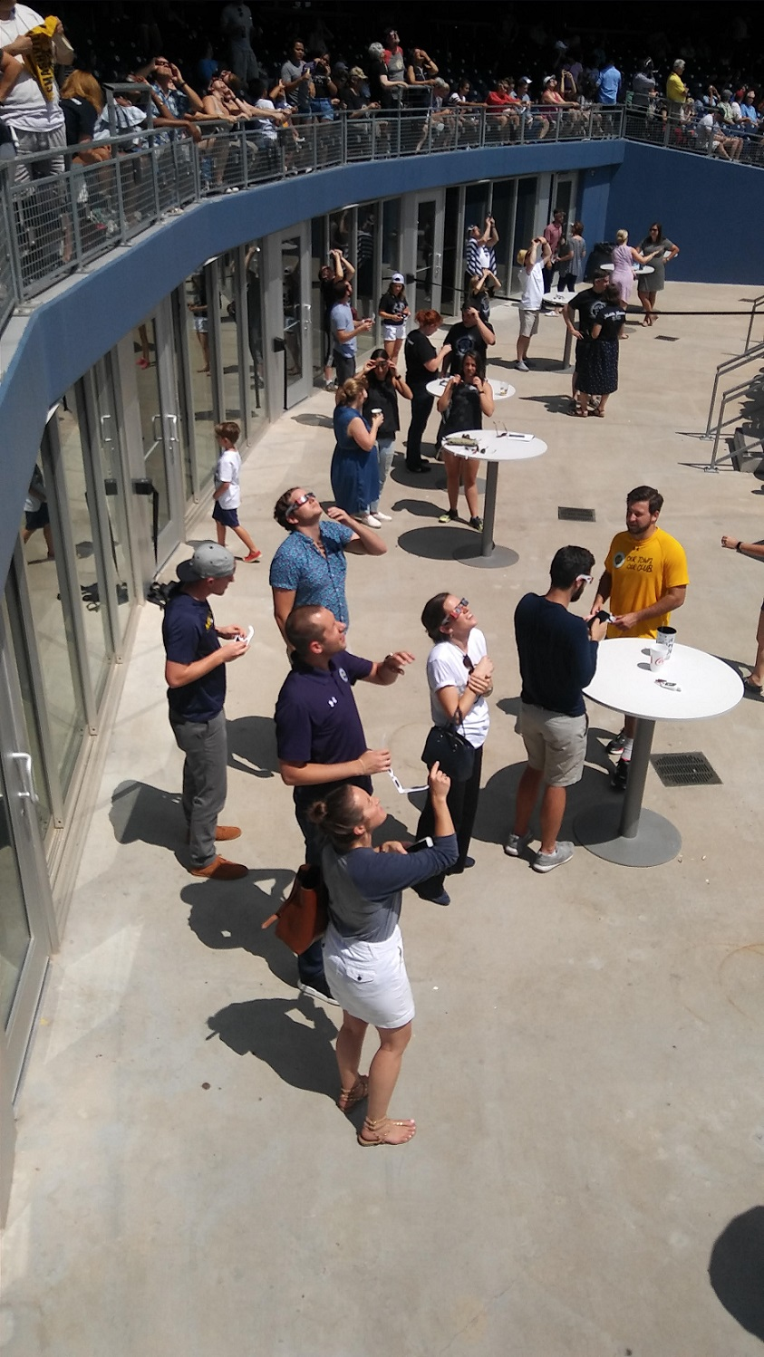 Nashville Sounds Crowd looking at the eclipse while wearing protective glasses on August 21, 2017