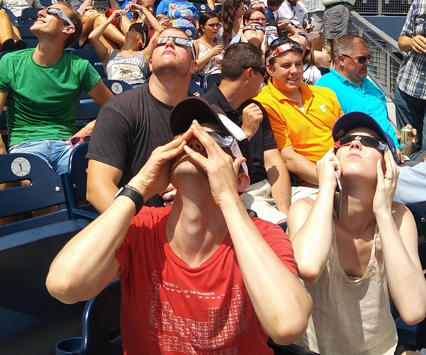 Nashville Sounds crowd looking at the eclipse while wearing protective glasses from the stands on August 21, 2017