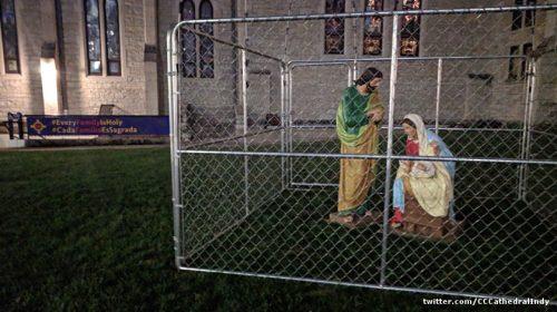 Joseph Mary Jesus in a cage