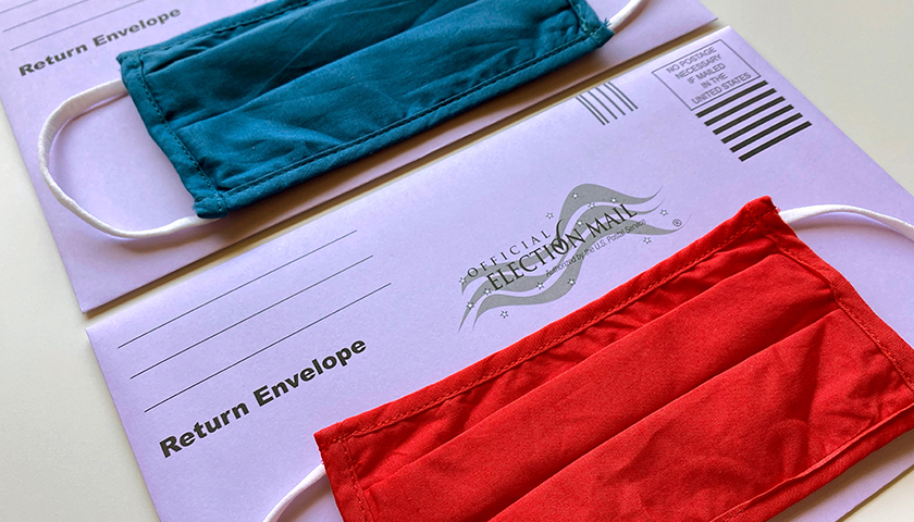 Mail in voting envelopes with masks on top
