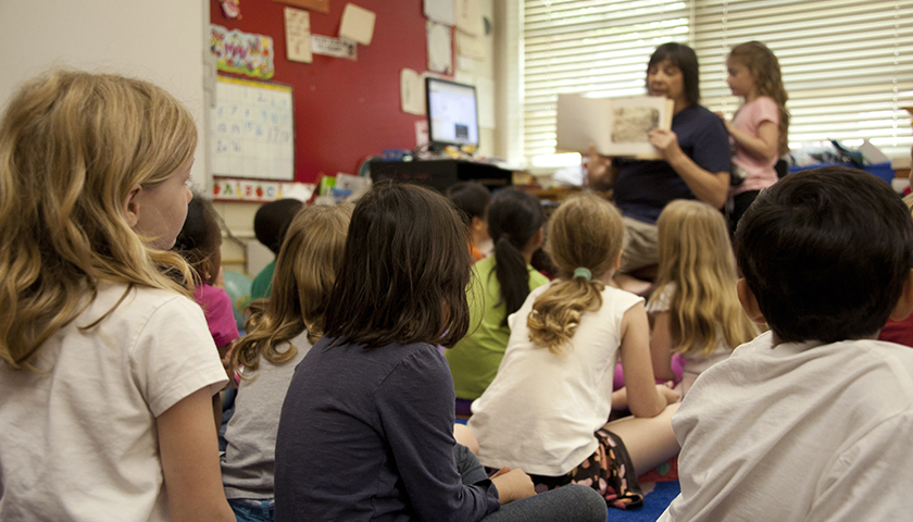 Classroom full of kids, that are being read a book