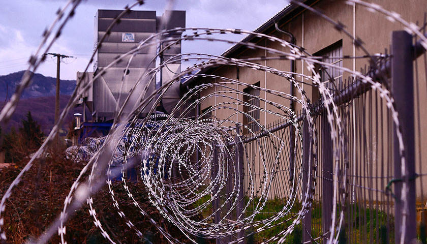 Close-up of barbed wire at a prison