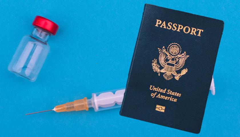 U.S. Passport with vaccine behind