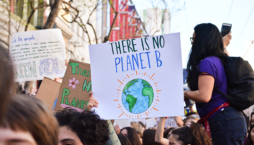 """There is no planet B"" sign"