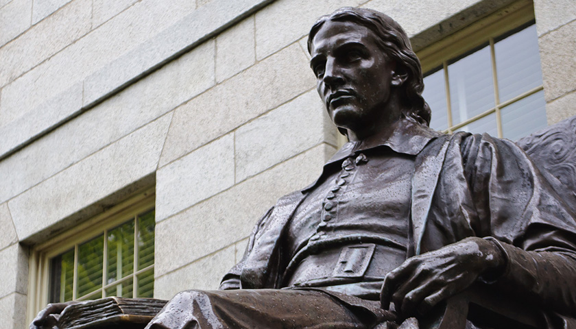 The statue of John Harvard, seen at Harvard Yard