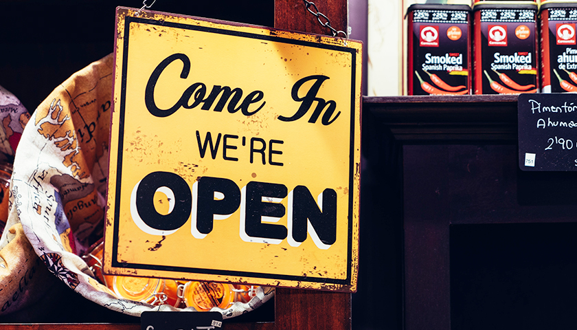 """Come in, we're open"" business sign"