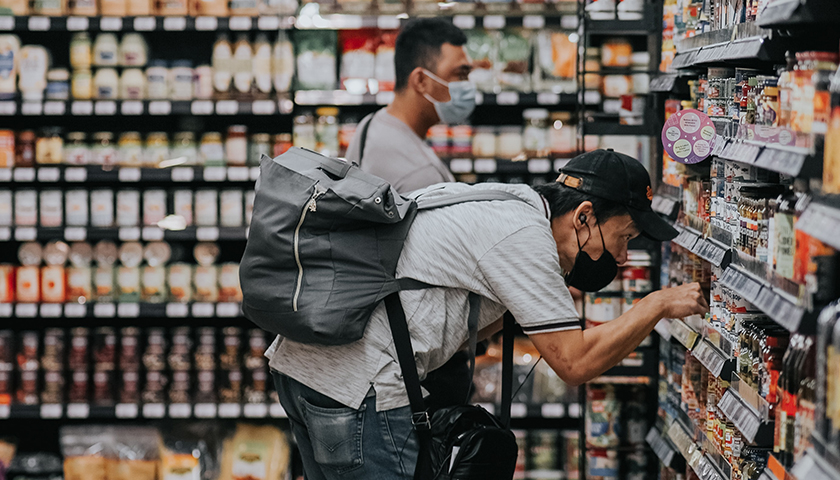Two men in grocery aisle, shopping
