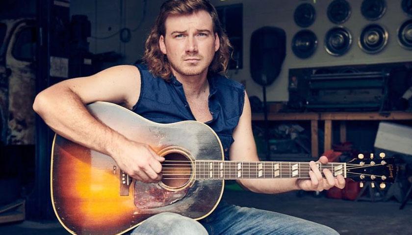 Morgan Wallen holding guitar.