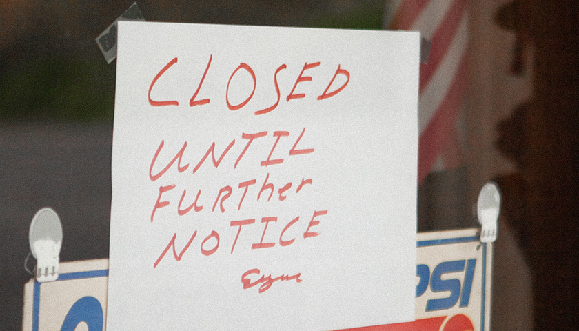 """""""Closed until further notice"""" sign"""