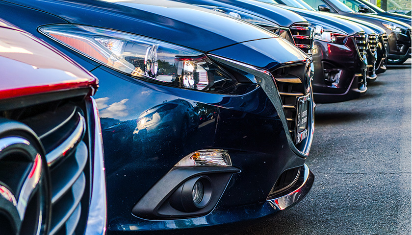 Close up of a line of cars