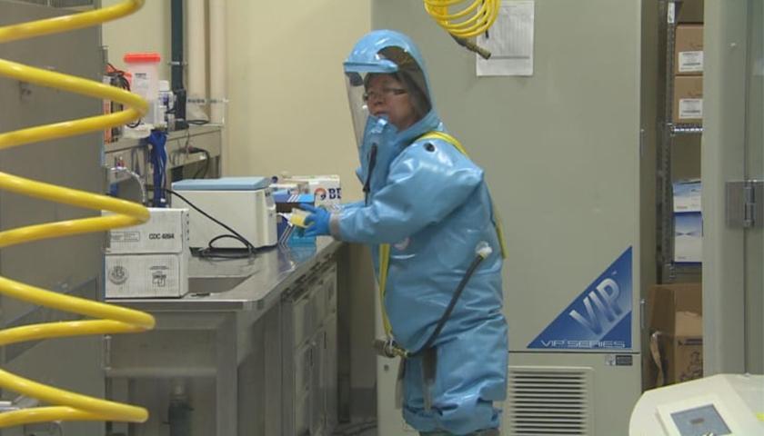 Person in lab gear