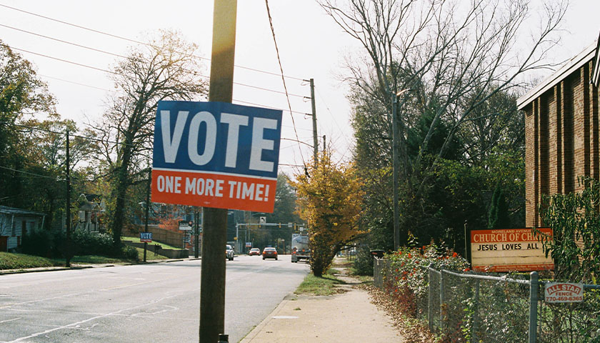 """""""VOTE ONE MORE TIME"""" sign on an electric pole in Atlanta, Georgia"""