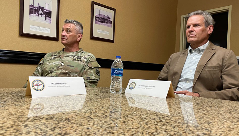 Gov. Bill Lee, on the right, sitting down in a room. Lee recently visited the southern border