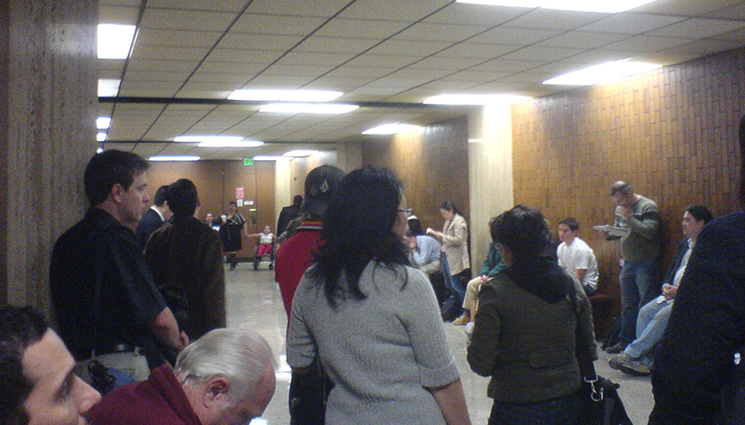 Group of people in room, waiting for jury selection