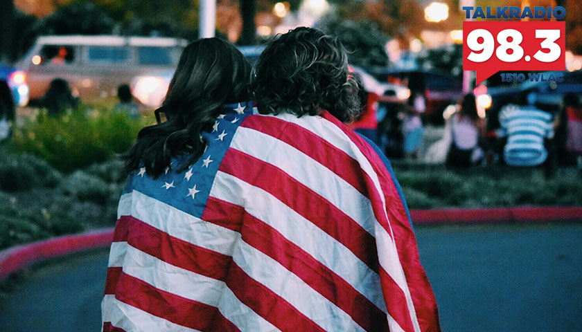 Woman and man covered up in American flag