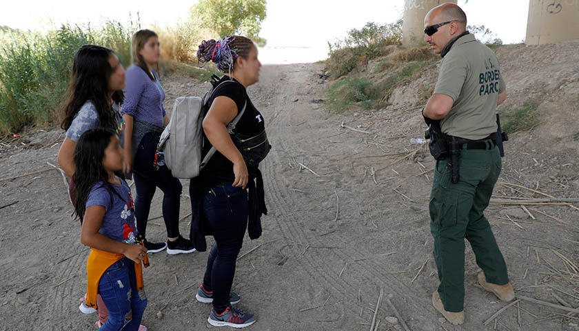 U.S. Border Patrol agents perform a water rescue and assist a migrant family in distress near Eagle Pass, Texas, August 20, 2019, CBP photo by Jaime Rodriguez Sr.