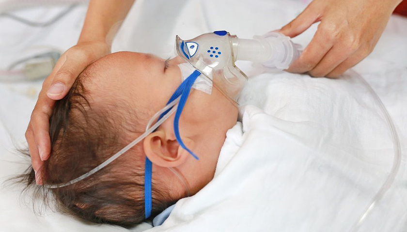 Baby with a respirator on