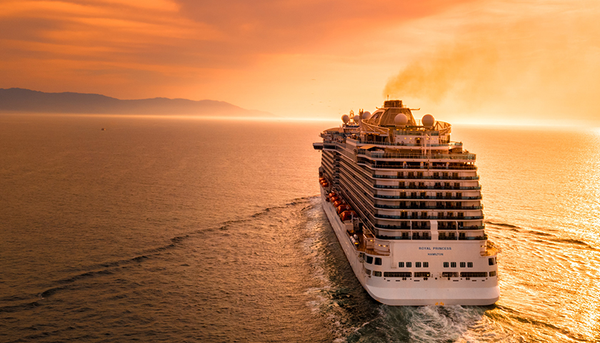 Cruise ship in the ocean during sunset