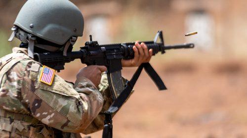 U.S. Military member shooting an AR.