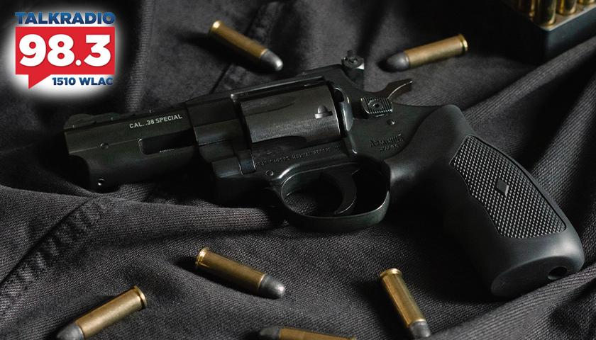 Black revolver with ammo