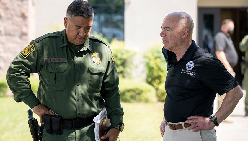 U.S. Dept. of Homeland Security Secretary Alejandro Mayorkas speaks with Chief of the U.S. Border Patrol Raul Ortiz as he tours the Del Rio Port of Entry in Del Rio, Texas, September 20, 2021.