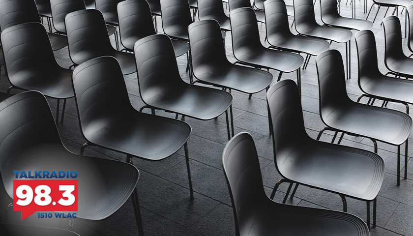 Empty room of black chairs