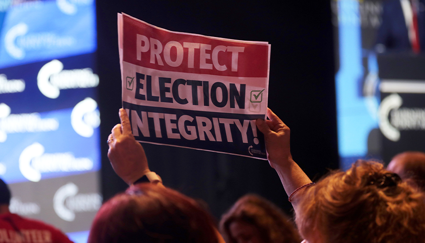 """Sign that says """"protect election integrity"""""""
