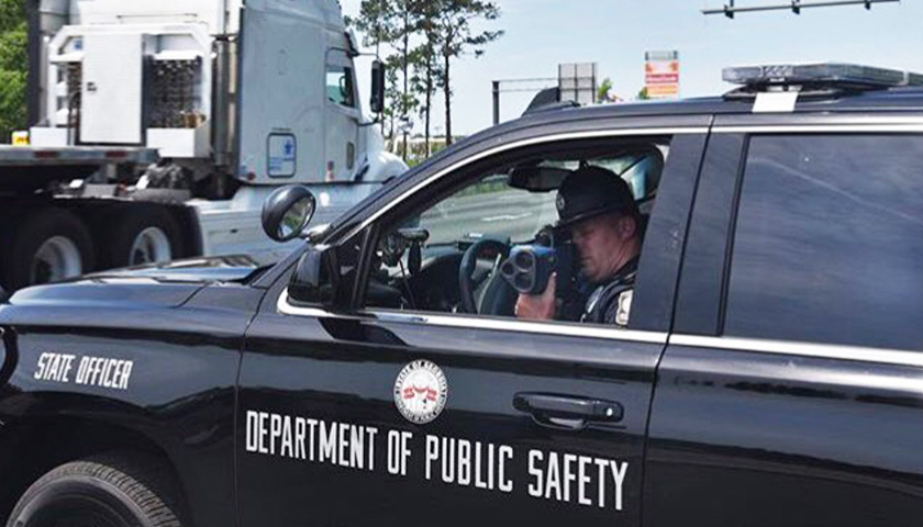officer using radar gun in SUV to check Georgia residents' speed