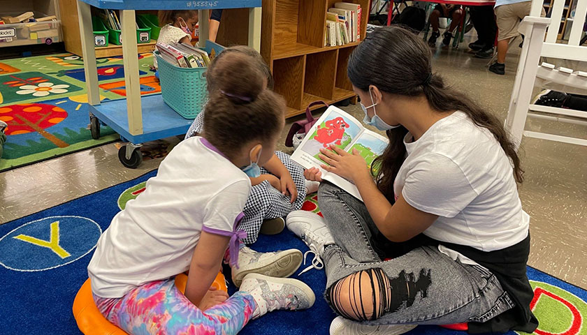 Cleveland Metropolitan School District 8th grade students read with their kindergarten buddies and help the young learners discover the joy of reading.