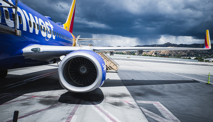 Southwest airlines plane with storm behind it